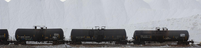 Mounds of salt next to train